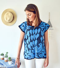 Load image into Gallery viewer, model wearing hand embroidered Mexican blouse with bright blue peacock