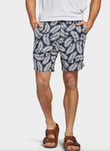 Load image into Gallery viewer, A classic cotton/linen short in this seasons must have print. The Dextra Short sits just above the knee and carries a fixed waist. Wear with a classic linen button-up or a tee for a more casual look.  Details:  45% Cotton / 55% Linen Printed fern design Heavy enzyme wash for an extra soft handfeel Fixed waist short which sits comfortably above the knee Chambray pocketing, back jet pockets with button closure Natural buttons with Academy logo Woven label at back pocket