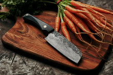 High quality hand made kitchen knife for chefs and foodies melbourne eats cooking from home chopping veggies in the kitchen like carrots for amatures and profeshional knifes hand forged in collingwood melbourne by 13knives blacksmith