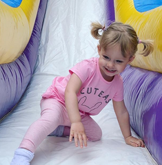 girl-jumping-castle-slide
