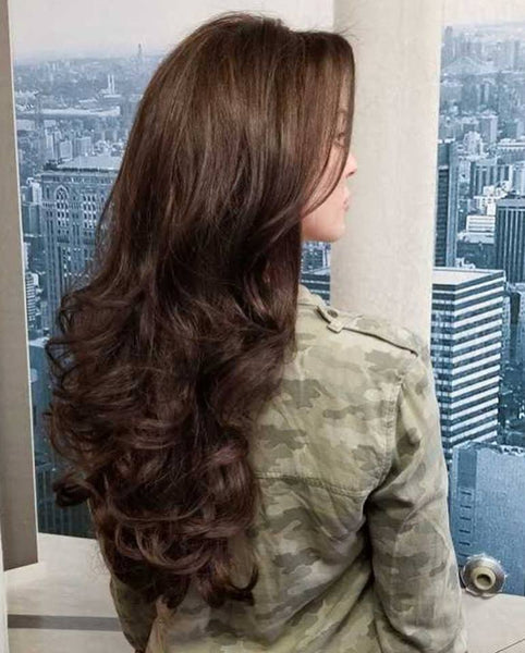Client wearing our Pure Remy Natural Wavy Hair Extensions