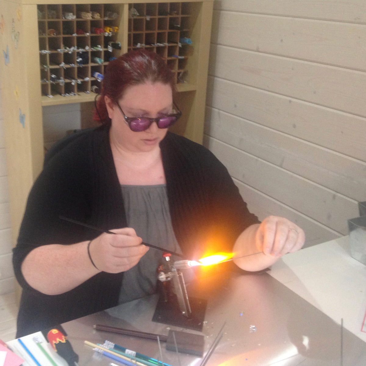 Ali Perry making lampwork glass beads at the torch
