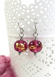 Cranberry pink and gold leaf bead earrings with oxidised silver earwires