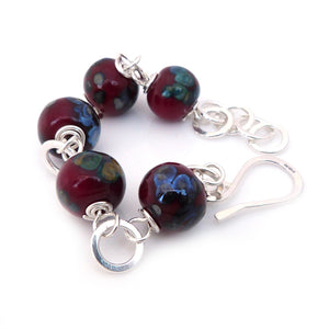 Red lampwork glass bead and silver bracelet with hook clasp