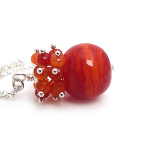 Orange Lampwork glass and carnelian gemstone pendant with sterling silver chain
