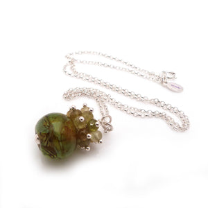 Olive green lampwork glass bead and grossular garnet pendant with sterling silver chain