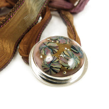 Lampwork and Sterling silver round pendant with silk ribbon tie