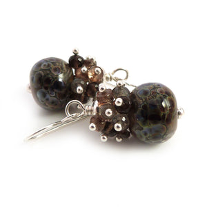 Brown lampwork glass bead earrings with clusters of brown and grey gemstones on sterling silver earwires
