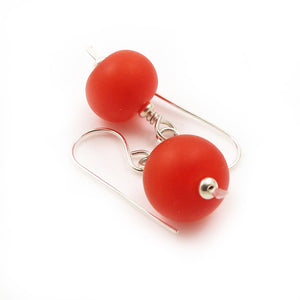 Sterling silver drop earrings with bright orange etched lampwork beads