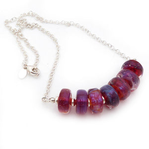 Silver necklace with ruby magenta lampwork glass wheel beads