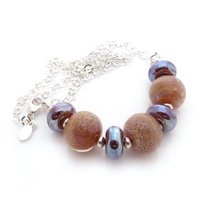 Peachy amber Lampwork glass necklace with silver chain