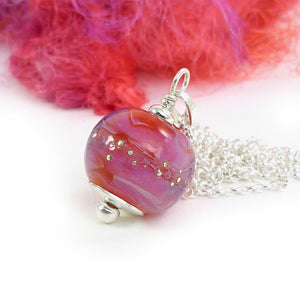 Hot pink lampwork glass bead pendant on a sterling silver chain