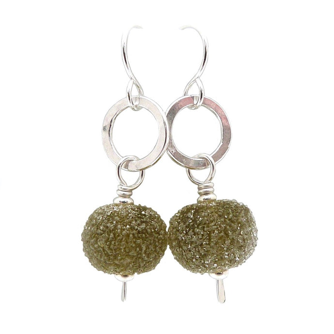 Drop earrings with silver circles and gooseberry green glass beads