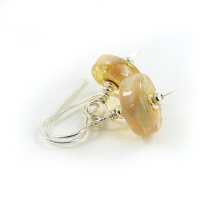 Opalescent yellow lamowork glass bead and sterling silver earrings