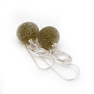Drop earrings with silver circles and gooseberry green glass bead drops