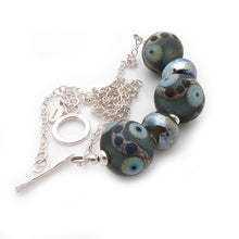 Steel blue Lampwork glass bead and silver necklace