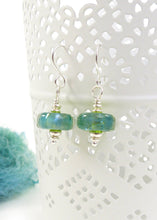 Green-blue lampwork glass bead and silver drop earrings