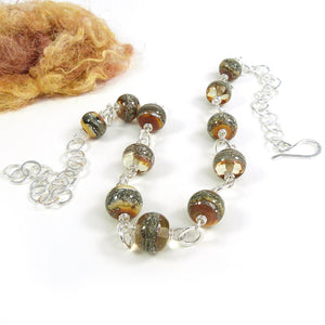 Yellow Lamowork glass and sterling silver necklace with hook clasp