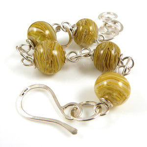 Mustard Yellow Lampwork Bead and silver bracelet