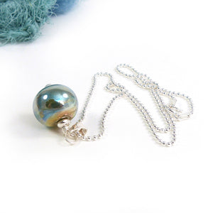Aqua and gold metallic glass bead pendant with sterling silver chain