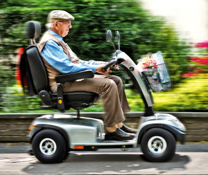 Elderly man on a mobility scooter