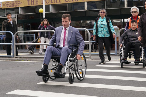David Seymour MP for Epsom propelling himself in a wheelchair