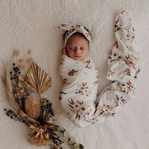 Boho posy jersey swaddle and topknot on baby