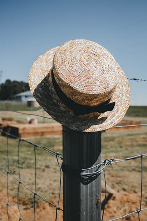 Straw boater hat with black band