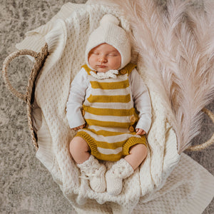 White merino wool bonnet and bootie set on baby