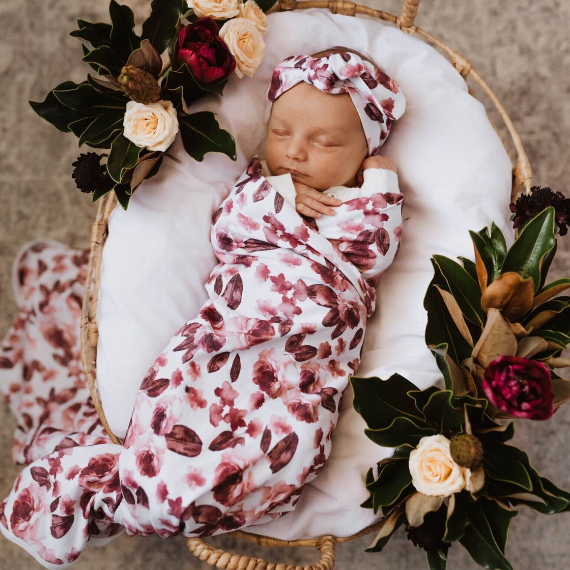 Fleur jersey swaddle and bow on baby