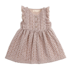 Sand coloured eyelet dress with three wooden buttons
