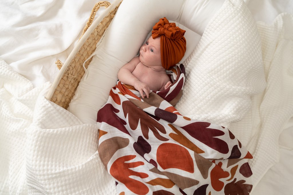 Montana Agate Swaddle wrapped around a baby