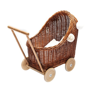 Natural wicker pram with pom poms