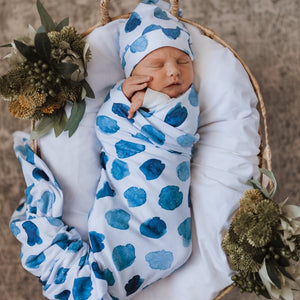 Baby wrapped in Ocean Skies jersey wrap and beanie