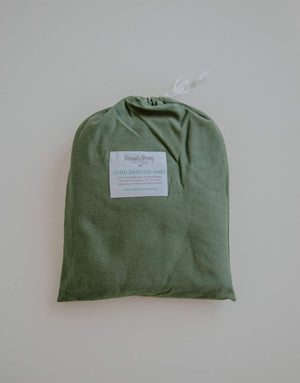 Olive green cot sheet in cot bag