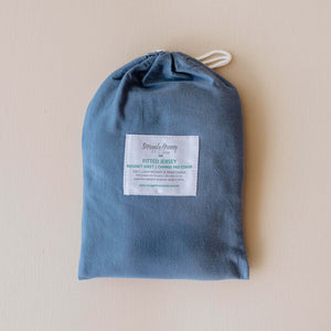 Photo navy blue bassinet sheet in navy blue protective bag