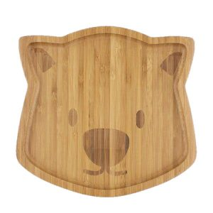 Bamboo plate in the shape of a wombat face