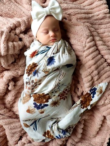 A floral Little Posy Wrap muslin Swaddle