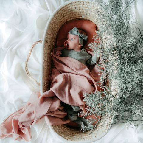 Baby wrapped in ballet blush swaddle