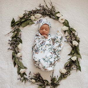 Eucalypt leaves baby jersey wrap and beanie on newborn