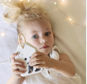 Little girl holding animal flash cards