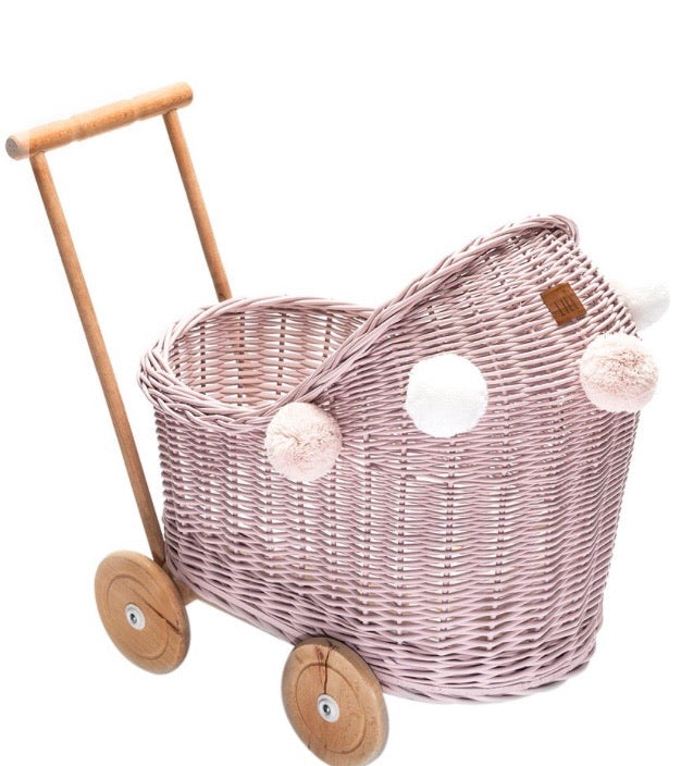 Dusty pink wicker dolls pram