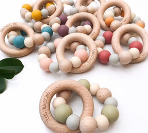 Mixed colours of the natural beech wood and silicone teethers