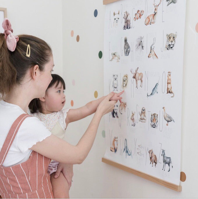 Two girls using the animal alphabet print