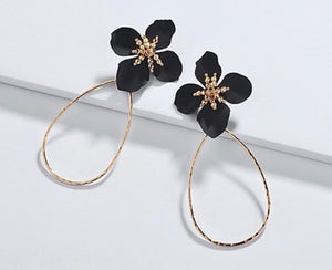 black flower on gold hoop