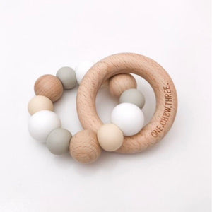 White silicone bead and natural beech wood teether