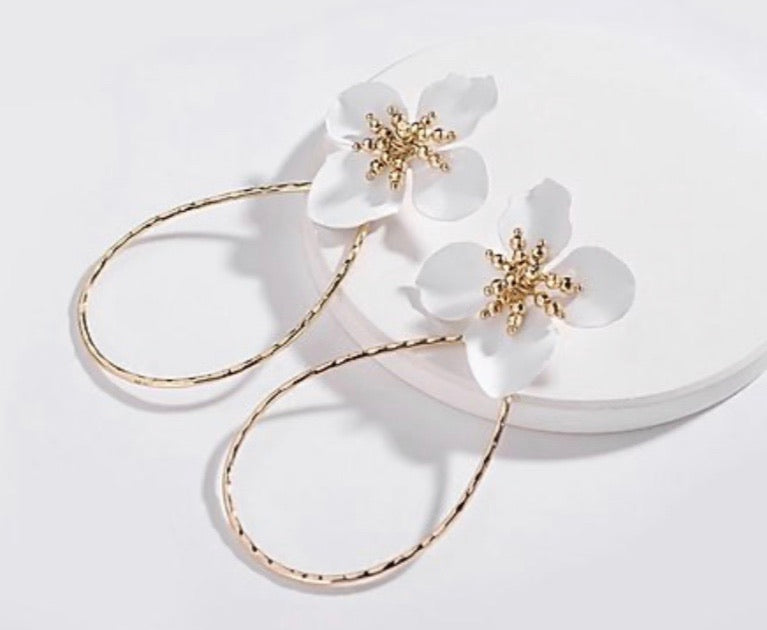white flower and gold hoop earrings