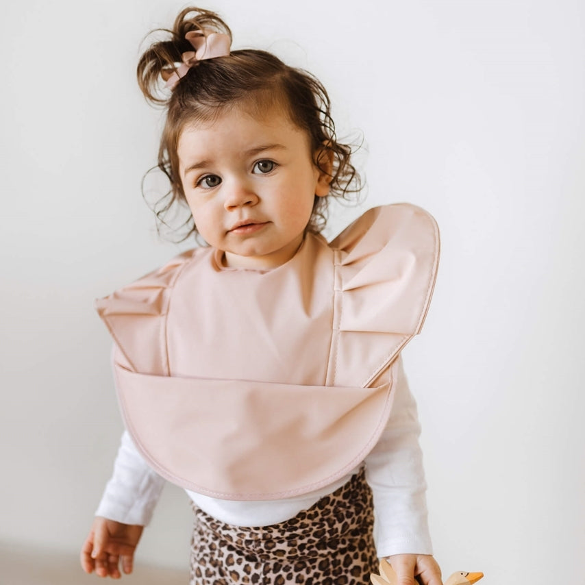 Little girl wearing nude snuggle hunny bib