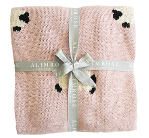 Pink knit blanket with sheep