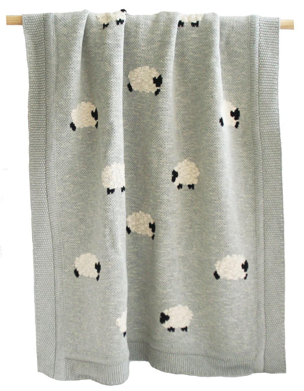 Grey knit blanket with sheep on it